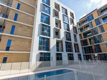 Dubai Properties hands over first tower at Dubai Wharf development three months Ahead of Schedule
